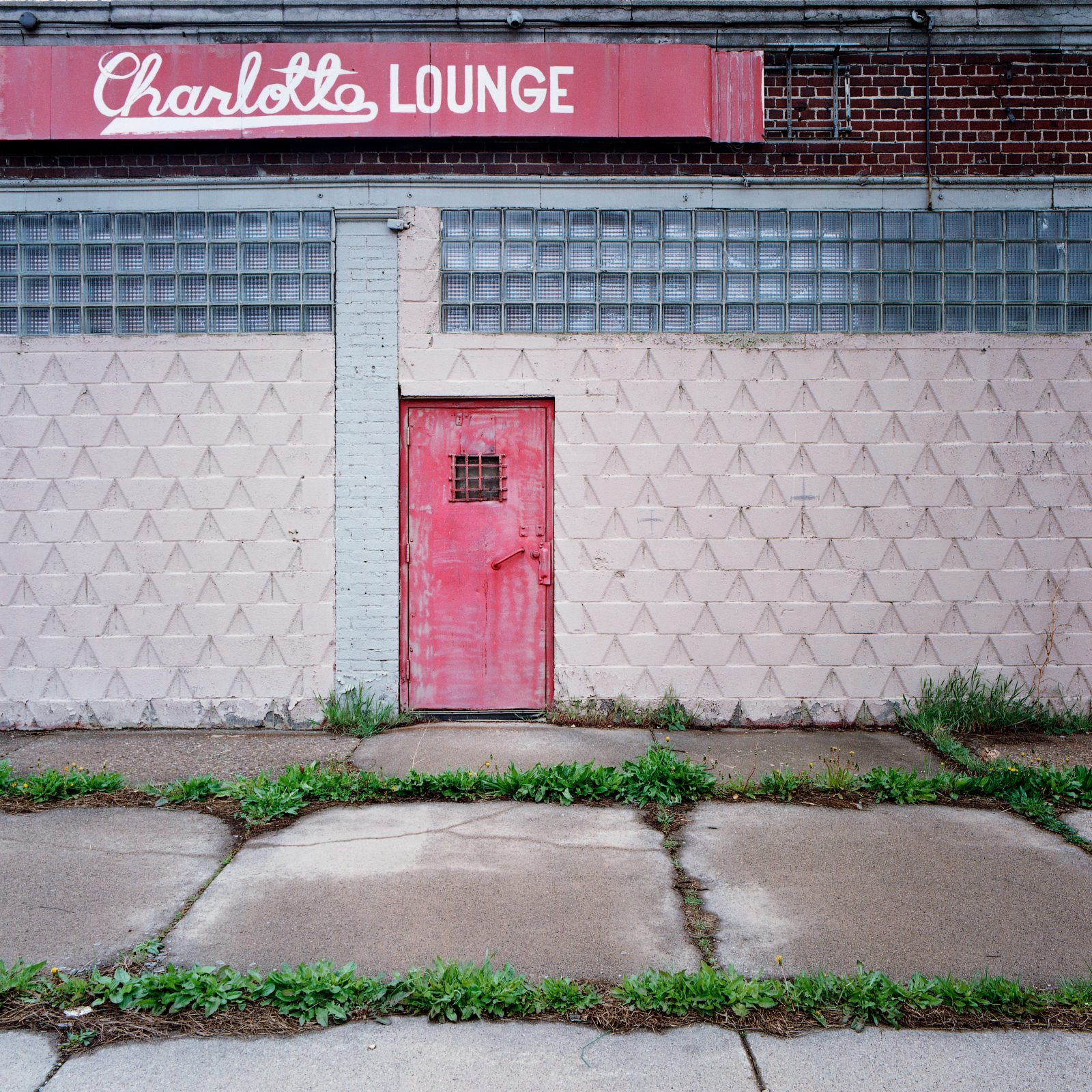 Charlotte Lounge door and sign