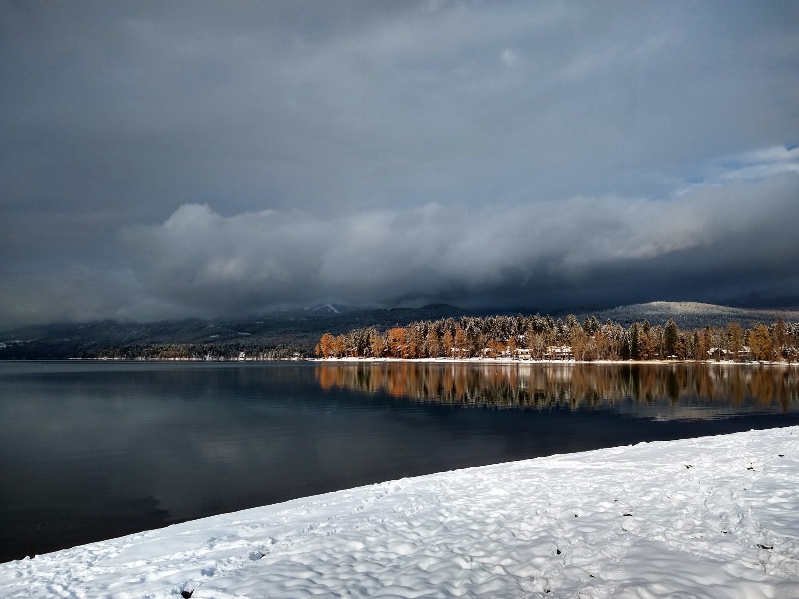 Snow, clouds, and Whitefish Lake